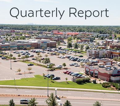 Aerial view of commercial development, titled &#34Quarterly Report&#34